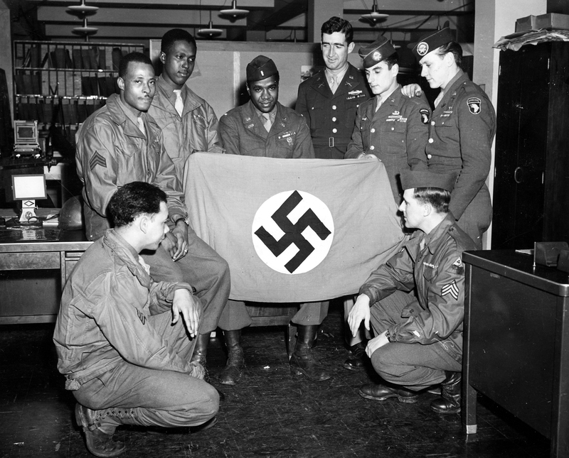 world war ii soldiers with captured nazi flag | harry s. truman  truman library