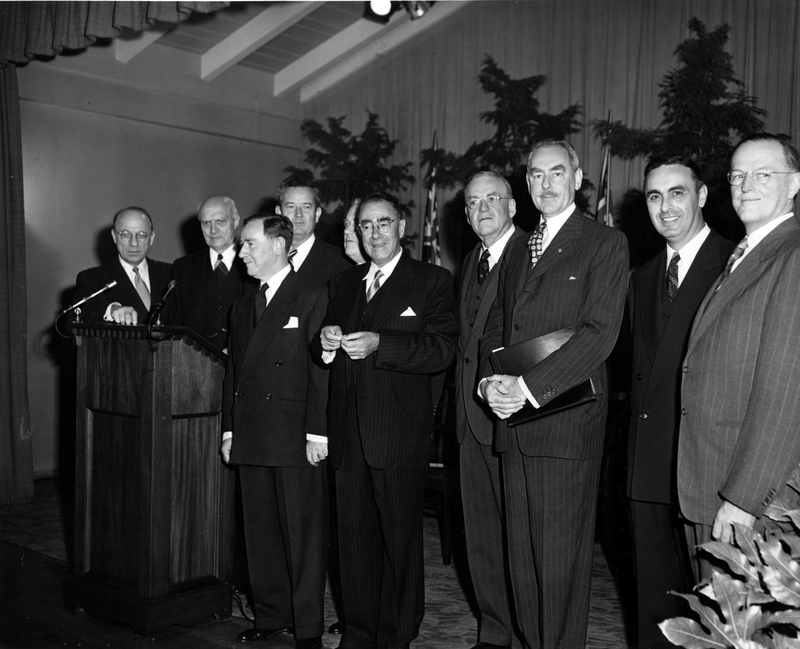 Dean Acheson and others at a conference relating to the draft tripartite treaty