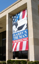 Harry Truman banner haning in building window