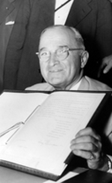 Truman signing North Atlantic Treaty document, July 25, 1949.